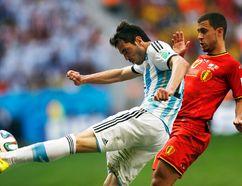 Argentina's Jose Basanta kicks the ball in front of Belgium's Eden Hazard during their World Cup quarterfinal match at Brasilia National Stadium in Brasilia, July 5, 2014. (UESLEI MARCELINO/Reuters)