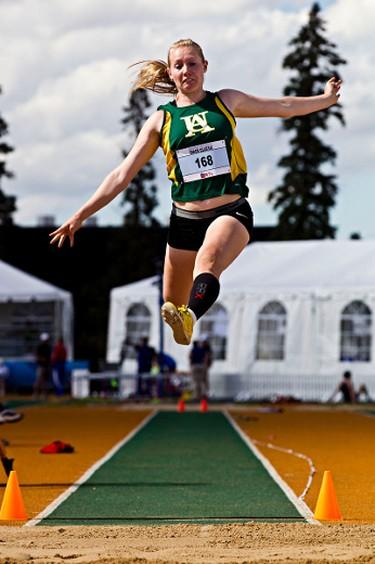 Alberta's Megan Ure competes in the women's long jump open during the Edmonton International Track Classic Open at Foote Field in Edmonton, Alta., on Saturday, July 5, 2014. Codie McLachlan/Edmonton Sun/QMI Agency