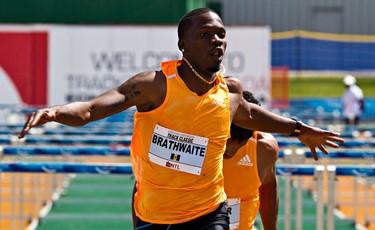 Barbados' Shane Brathwaite finishes the men's 110M hurdles event during the Edmonton International Track Classic at Foote Field in Edmonton, Alta., on Sunday, July 6, 2014. Codie McLachlan/Edmonton Sun/QMI Agency
