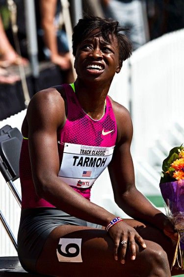 USA's Jeneba Tarmoh rests after winning the women's 100M dash event during the Edmonton International Track Classic at Foote Field in Edmonton, Alta., on Sunday, July 6, 2014. Codie McLachlan/Edmonton Sun/QMI Agency