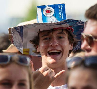 A young man with a homemade beer carton cowboy hat watches David Nail at Bluesfest July 6, 2014. Errol McGihon/Ottawa Sun/QMI Agency
