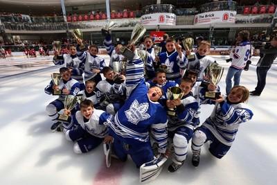 Toronto Pro Hockey members celebrates after winning the Brick Invitational Hockey Tournament at West Edmonton Mall in Edmonton, Alberta on Sunday, July 6, 2014.  Perry Mah/Edmonton Sun/QMI Agency