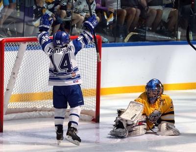 Toronto Pro Hockey's Mick Thompson celebrates after winning goal against the Toronto Bulldogs at the Brick Invitational Hockey Tournament at West Edmonton Mall in Edmonton, Alberta on Sunday, July 6, 2014.  Perry Mah/Edmonton Sun/QMI Agency