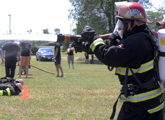 <p>Ingleside firefighter Kevin ter Horst practises his aim at the 2011 Ingleside Firefighter Challenge</p><p>CORNWALL STANDARD-FREEHOLDER file photo/QMI AGENCY