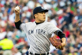 New York Yankees starting pitcher Masahiro Tanaka throws against the Minnesota Twins at Target Field in Minnesota, July 3, 2014. (JESSE JOHNSON/USA Today)