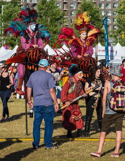 An artistic group entertains the crowd at Bluesfest in Ottawa on Thursday July 10, 2014. Errol McGihon/Ottawa Sun/QMI Agency