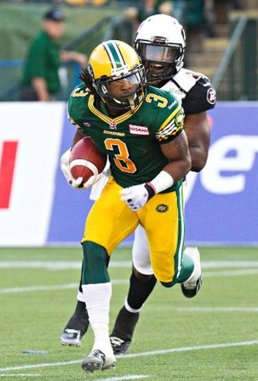 Edmonton's Jamal Miles (3) is pursued by Ottawa's Jasper Simmons (31) during the first half of the Edmonton Eskimos' CFL football game against the Ottawa RedBlacks at Commonwealth Stadium in Edmonton, Alta., on Friday, July 11, 2014. Codie McLachlan/Edmonton Sun/QMI Agency