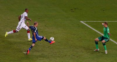 Argentina's Rodrigo Palacio challenges Germany's goalkeeper Manuel Neuer during their 2014 World Cup final at the Maracana stadium in Rio de Janeiro July 13, 2014. (REUTERS/David Gray)