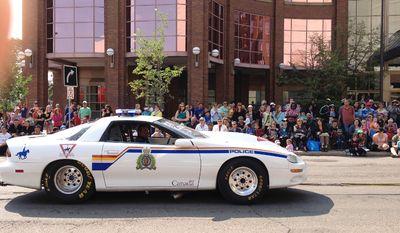 The Edmonton Police Service street legal car makes its way through the 2014 K-Days parade in downtown Edmonton. K-Days runs from July 18 to 27, 2014. Ian Kucerak/Edmonton Sun/QMI Agency