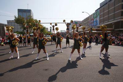 The Edmonton Eskimos cheerleaders perform during the K-Days Parade in downtown Edmonton, Alta., on Friday, July 18, 2014. The fair runs at Northlands until July 27. Ian Kucerak/Edmonton Sun/QMI Agency
