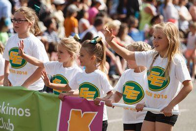 Young Edmonton Eskimos Eski-Mini cheerleaders wave during the K-Days Parade in downtown Edmonton, Alta., on Friday, July 18, 2014. The fair runs at Northlands until July 27. Ian Kucerak/Edmonton Sun/QMI Agency
