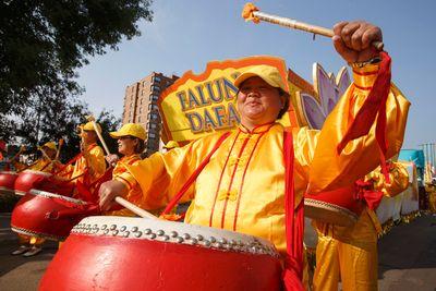 Falun Dafa drummers warm up before the K-Days Parade in downtown Edmonton, Alta., on Friday, July 18, 2014. The fair runs at Northlands until July 27. Ian Kucerak/Edmonton Sun/QMI Agency