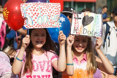 Alexa Posa, (left) and Jessica Zilinski make custom K-Days signs to wave during the K-Days Parade in downtown Edmonton, Alta., on Friday, July 18, 2014. The fair runs at Northlands until July 27. Ian Kucerak/Edmonton Sun/QMI Agency