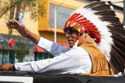 Treaty 6 Grand Chief Craig Makinaw waves during the K-Days Parade in downtown Edmonton, Alta., on Friday, July 18, 2014.  Ian Kucerak/Edmonton Sun/QMI Agency