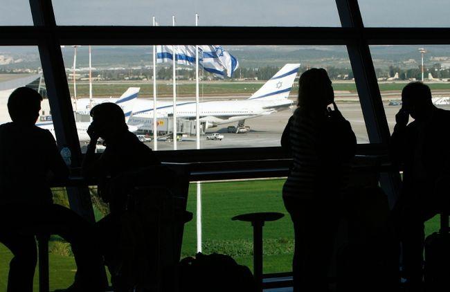 People sit inside Israel's Ben-Gurion International Airport near Tel Aviv in a January 5, 2010 file photo. (REUTERS/Ronen Zvulun/files)