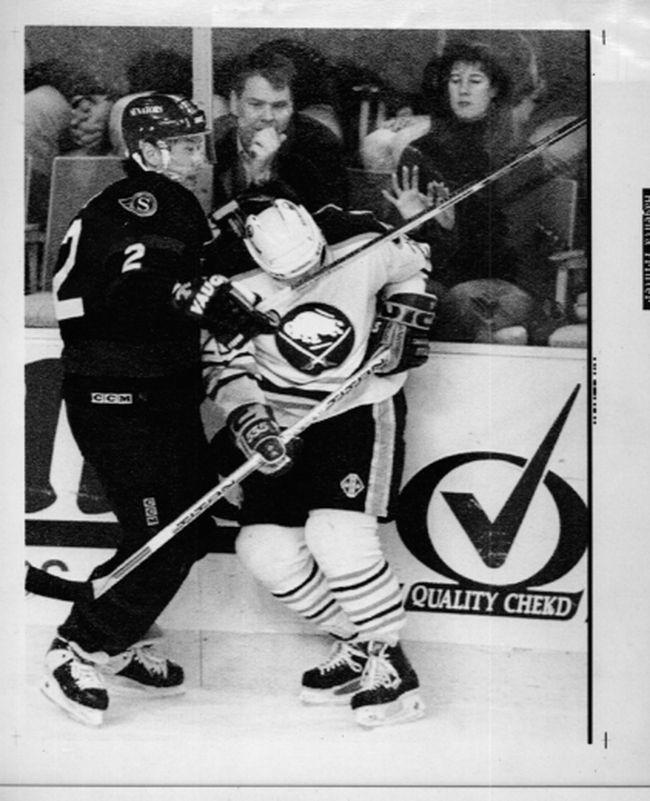 Ottawa Senators' Jim Paek checks Buffalo Sabres' Donald Audette during a 1995 game at the Buffalo Memorial Auditorium. (QMI Agency)
