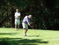 Glenn Keddie tees off on the third hole during the 2014 Grande Prairie Seniors' Golf Tournament at the Grande Prairie Golf and Country Club on Resources Road in Grande Prairie, Alberta on July 21, 2014. Tom Bateman/DAILY HERALD-TRIBUNE/QMI AGENCY