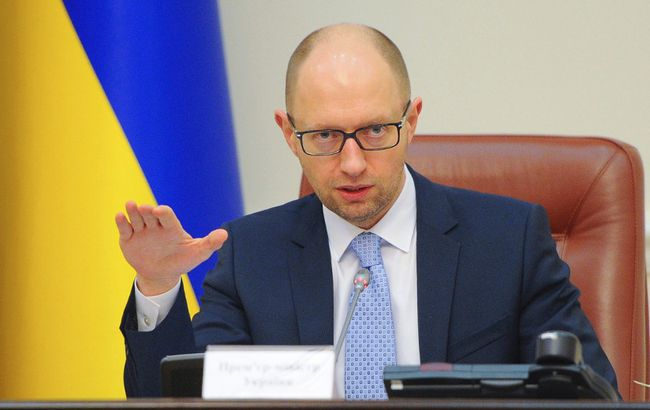 Ukraine's Prime Minister Arseny Yatseniuk speaks during a government meeting in Kiev, June 25, 2014. (REUTERS/Andrew Kravchenko/Pool)