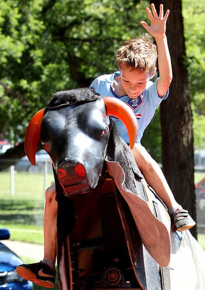 Kayden Dugas, 9, rides a mechanical bull during the 2nd annual Ronald McDonald House Northern Alberta Block Party, near 7726 - 107 St., in Edmonton Alta., on Sunday July 27, 2014. David Bloom/Edmonton Sun/ QMI Agency