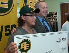 Connor Croken collects his 50/50 cheque from the Edmonton Eskimos, July 29, 2014. (EDMONTON SUN)
