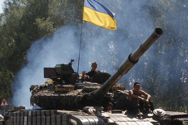 Ukrainian soldiers ride on a tank as they patrol the area near eastern Ukrainian town of Debaltseve Aug. 3, 2014. REUTERS/Valentyn Ogirenko