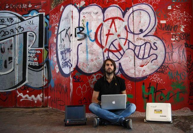 Cybersecurity researcher Ruben Santamarta poses for a photo in Coslada, near Madrid, July 30, 2014.  REUTERS/Andrea Comas