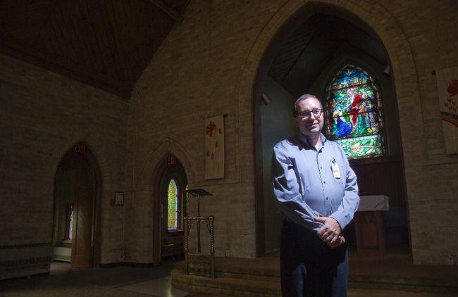 """It's a beautiful old chapel. It has a lot of history."" - Dale Jardine, shown standing inside the church (DEREK RUTTAN, The London Free Press)"