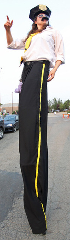 The long legs of the law were out during the 2014 Edmonton International Fringe Festival kick-off parade in Old Strathcona. Let the Fringe plays begin! For full coverage go to www.EdmontonSun.com/Festivals Hugo Sanchez/Edmonton Sun/QMI Agency