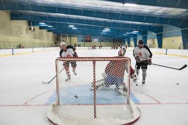 Players take shots on Arizona Coyotes goaltender Devan Dubnyk during the Perry Pearn's 3 vs. 3 Hockey Camp at K of C Twin Arenas in Edmonton, Alta., on Thursday, Aug. 21, 2014. Ian Kucerak/Edmonton Sun/ QMI Agency
