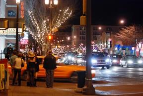Pedestrians walk along Whyte Avenue at night. Photo Courtesy/City of Edmonton