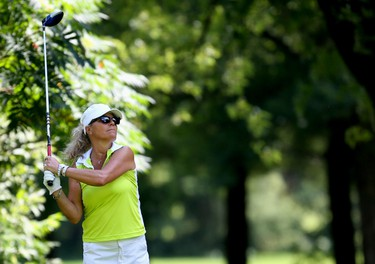 OTTAWA � Aug 23, 2014 � Marie Lusson watches her drive at Club de golf Outaouais during the Ottawa Sun Scramble's Championship Saturday. (Chris Hofley/Ottawa Sun)