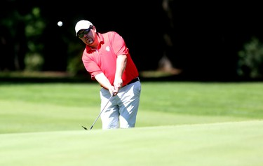 OTTAWA — Aug 23, 2014 — Wiliam McMurry chips a shot onto the green at Club de golf Outaouais during the Ottawa Sun Scramble's Championship Saturday. (Chris Hofley/Ottawa Sun)