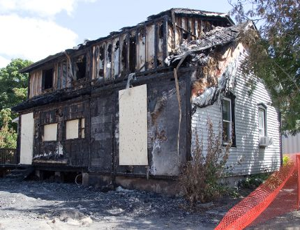 A house on Dyer St. in Belmont was struck by an arsonist Saturday. (DEREK RUTTAN, The London Free Press)