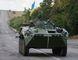 Ukrainian servicemen ride in an armoured vehicle near Debaltseve, Donetsk region, August 29, 2014. (REUTERS/Gleb Garanich)