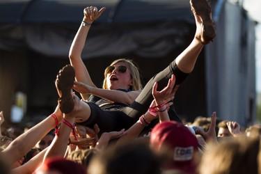A fan crowd surfs as Tegan and Sara perform on stage during SONiC BOOM 2014 at Northlands in Edmonton, Alta., on Saturday, Aug. 30, 2014. The multi-artist show runs through Sunday, Aug. 31. Ian Kucerak/Edmonton Sun/ QMI Agency