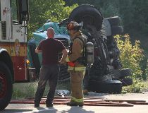 Tanker truck rolls, driver note injured