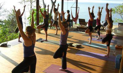 Morning yoga on the deck at Anamaya Resort, a yoga/surf retreat in Costa Rica. ANAMAYA RESORT PHOTO
