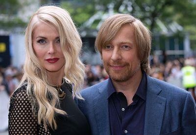 Director Morten Tyldum and Janne Tyldum on the red carpet for movie