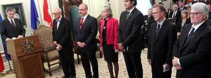 New Alberta Premier Jim Prentice introduces new his new cabinet members Stephen Mandel, Maureen Kubinec, Stephen Khan, Gordon Dirks, and David Dorward