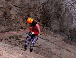 Natalie Spooner dangles from a cliff in New Brunswick (Screen grab)