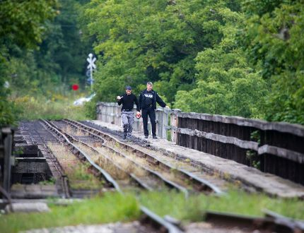 Police walk across railway trestle bridge in St. Thomas, Ontario on Monday, September 15, 2014. (DEREK RUTTAN, The London Free Press)