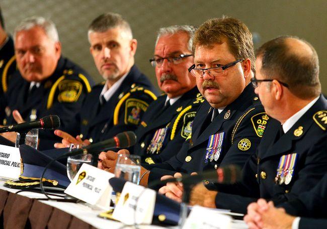 Det.-Sgt. Frank Goldschmidt, OPP provincial strategy co-ordinator, provides an update on a province-wide child-pornography bust Thursday, Sept. 25, 2014. (DAVE ABEL/Toronto Sun)