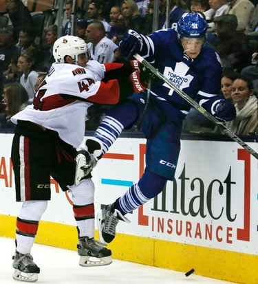 Leafs' Jake Gardiner gets nailed by Senators' Jean-Gabriel Pageau. Toronto Maple Leafs vs the Ottawa Senators at the Air Canada centre in Toronto on Wednesday September 24, 2014. Craig Robertson/QMI Agency