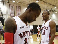 Raptors' DeMar DeRozan (right) and Terrence Ross have some fun between shots at Raptors' media day on Monday. (Craig Robertson/Toronto Sun/QMI Agency)