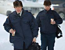 RCMP offers are seen wearing a muskrat fur hat in this file photo taken January 11, 2011. (JORDAN VERLAGE/QMI AGENCY)