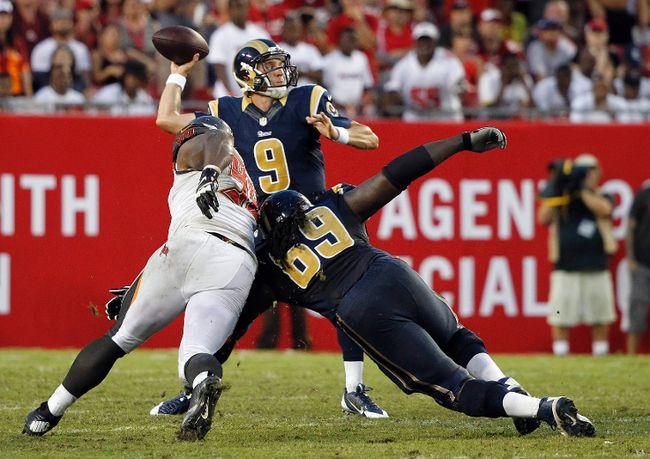 St. Louis Rams quarterback Austin Davis throws the ball as Tampa Bay Buccaneers defensive tackle Clinton McDonald rushes and  Rams guard Davin Joseph blocks at Raymond James Stadium on September 14, 2014. (Kim Klement/USA TODAY Sports)