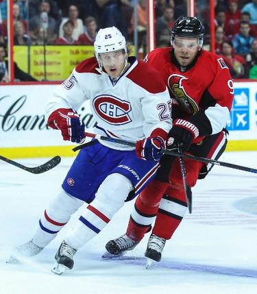 Ottawa Senators' Milan Michalek battles with Montreal Canadiens' Jacob De La Rose during NHL pre-season hockey action at the Canadian Tire Centre in Ottawa, Ontario on Friday October 3, 2014. Errol McGihon/Ottawa Sun/QMI Agency