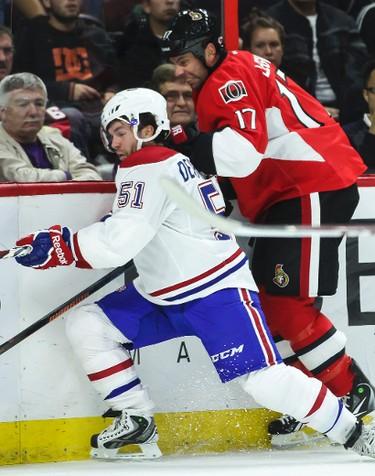 Ottawa Senators' David Legwand battles along the boards with Montreal Canadiens' David Desharnais during NHL hockey action at the Canadian Tire Centre in Ottawa, Ontario on Friday October 3, 2014. Errol McGihon/Ottawa Sun/QMI Agency