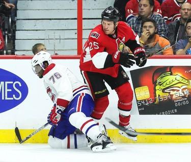 Ottawa Senators' Chris Neil battles with Montreal Canadiens' P.K. Subban during NHL hockey action at the Canadian Tire Centre in Ottawa, Ontario on Friday October 3, 2014. Errol McGihon/Ottawa Sun/QMI Agency