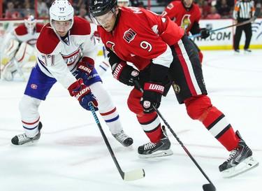 Ottawa Senators' Milan Michalek battles with Montreal Canadiens' Tom Gilbert during NHL pre-season hockey action at the Canadian Tire Centre in Ottawa, Ontario on Friday October 3, 2014. Errol McGihon/Ottawa Sun/QMI Agency